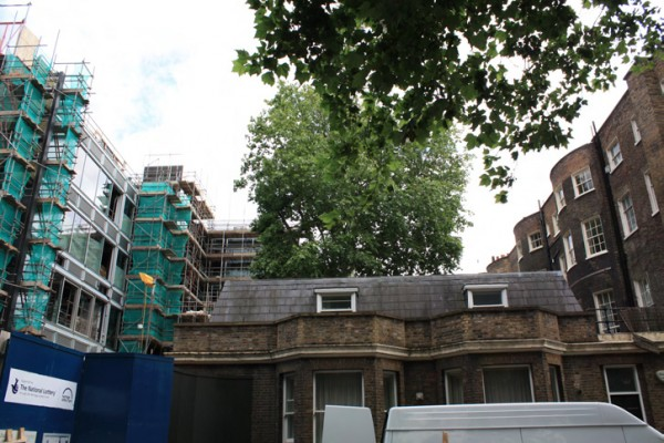 The unfortunate confrontation of the elegant bow windows of the listed buildings on Bedford Square with the glass and metal facade of the British Museum Northwest Extension.