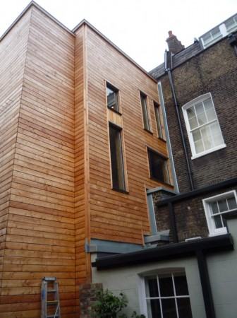 The rear extension of the Dickens Museum on Doughty Street is both over bulky and uses completely inappropriate materials. The effort to 'make a statement' has over-ridden the need to be neighbourly.